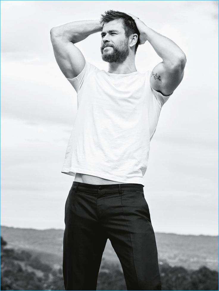 Actor Chris Hemsworth flexes his biceps for a GQ Australia photo shoot.