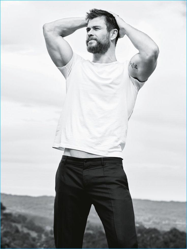 Actor Chris Hemsworth flexes his biceps for a GQ Australia photo shoot.
