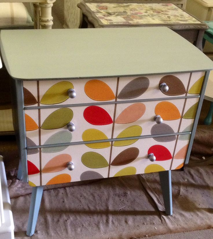 Retro drawers with Orla Kiely wallpaper added to drawer fronts
