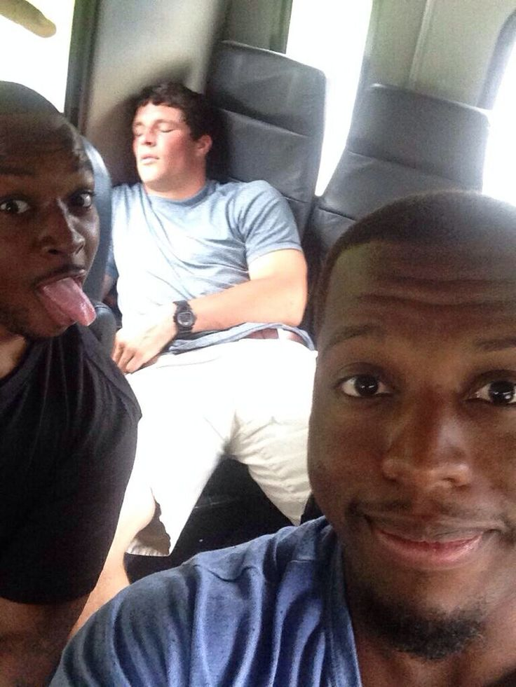 Bless his heart haha! Jonathan Stewart and Mike Tolbert catch Luke sleeping on the way to Panthers Road Show in Greensboro, NC