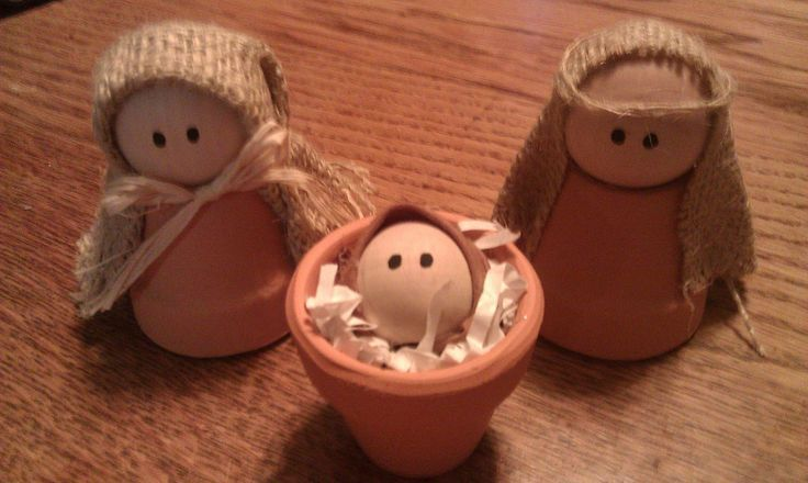 """Nativity Craft ...  Handmade nativity includes baby Jesus, Mary and Joseph.  Clay pots are left natural – not painted. Burlap is used for headdress.  Made from 1 1/2"""" clay pots 1 1/2 """" wooden balls are used for the heads of Mary and Joseph. 1"""" wooden balls form baby Jesus Height is approximately 3"""".:"""