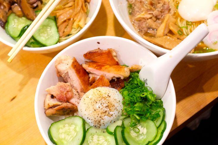 Noodle bowls (clockwise from center): chicken and egg with rice, ginger scallion noodles, Momofuku ramen (Momofuku Noodle Bar)