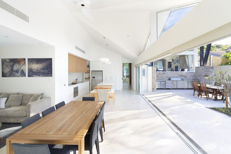 Open plan family, dining and kitchen. Full width connection to courtyard.