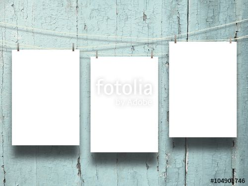 #Three #blank #frames with #pegs on #weathered #aqua #wooden #boards #background