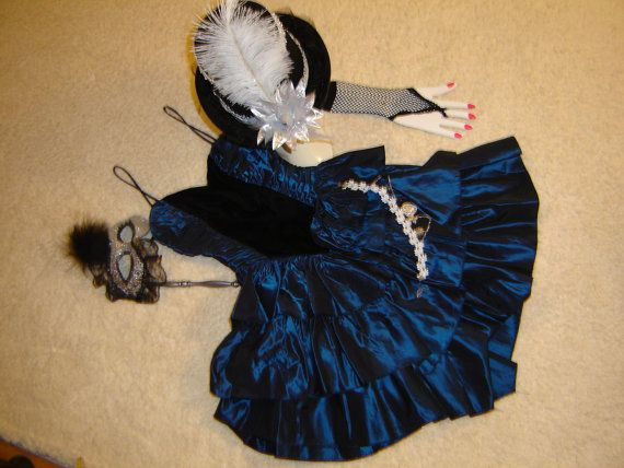 This would be a great costume for Halloween- a ringmaster, circus, lion tamer, etc.,  Dark blue taffeta Gunne Sax dress, spaghetti straps, black velvet front panel with ruched sides, full, 3 tiered ruffle skirt accessories include a black top hat with silver and white trim, mask on a stick, white lac choker, and black mesh mitts..   WOW QUALITY and FUN!  Size marked a Gunne Sax womens 3 -PLEASE COMPARE TO YOUR MEASUREMENTS--30(SMALL) bust,, waist 23, 21 length from waist.  Excellent…