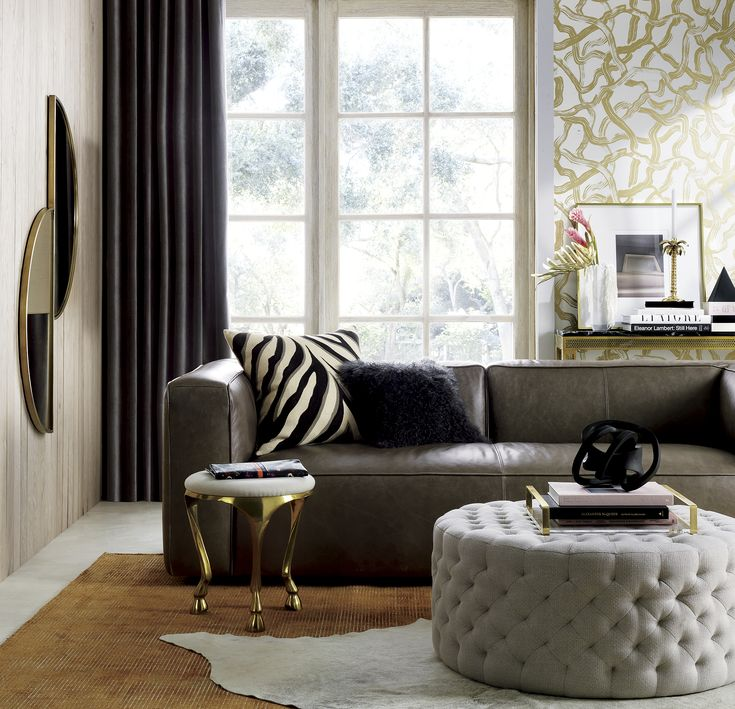 Ivory Tufted Leather Sectional Sofa And Ottoman