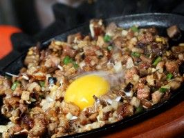 Pork Sisig. A classic Filipino entree. Traditionally paired with Garlic Fried Rice and accompanied by ice-cold San Miguel Beer.