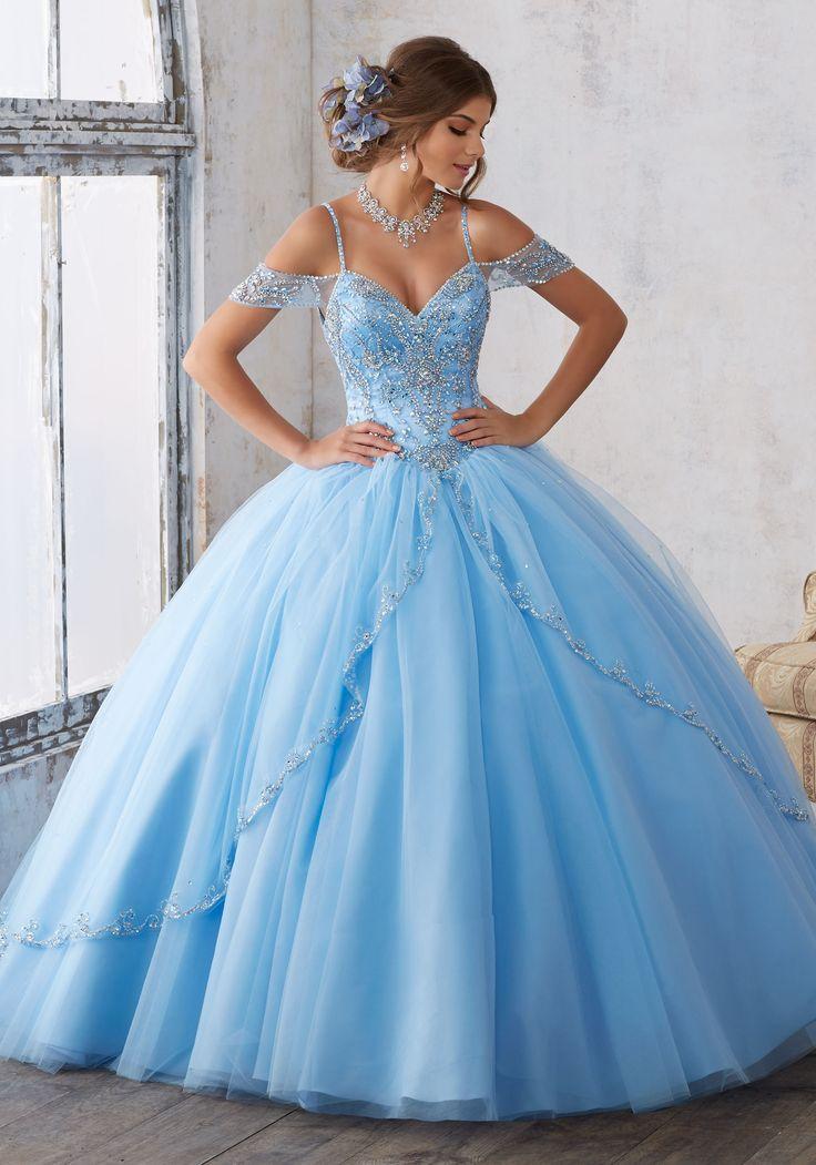 Morilee Quinceanera Dresses  STYLE NUMBER: 89135 Jeweled Beading on a Split Front Tulle Ballgown  Dramatic and Elegant, This Quinceañera Ballgown Beautifully Combines an Intricately Beaded Bodice Featuring Off-the-Shoulder Cap Sleeves, with a Traditional Split Front Tulle Skirt. Matching Stole Included. Corset Back. Colors Available: Bahama Blue, Black Cherry, Royal, White.