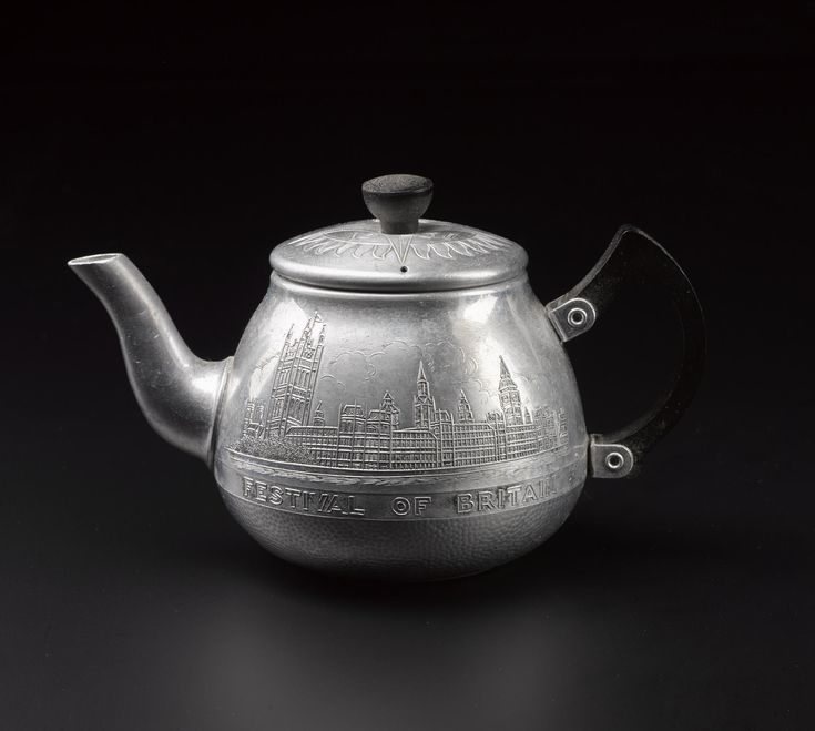 Festival of Britain souvenir teapot and lid, silver aluminium with black bakelite handle and knob, with engraved images of London Bridge and the Houses of Parliament, the dates of the Festival and the Festival symbol; British, by Swan, 1951