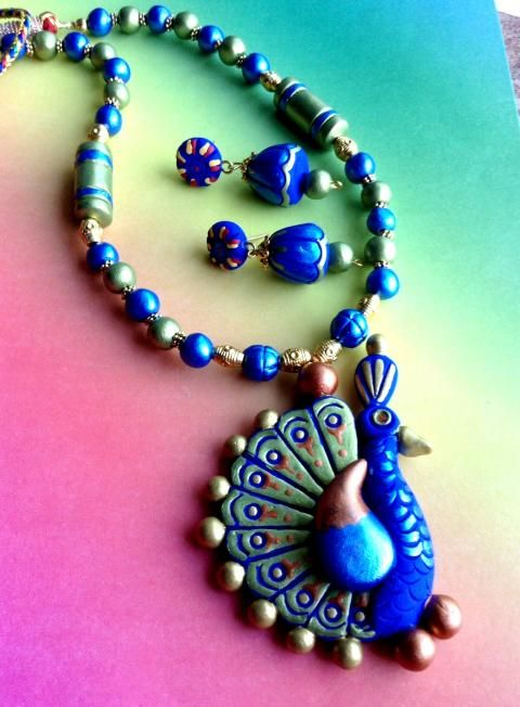 ❤❤.. Latest stylish Handmade Peacock Terracotta #Necklace with Jhumka Earrings for fashion-freak women. Order now before it gets sold out!!! ❤❤