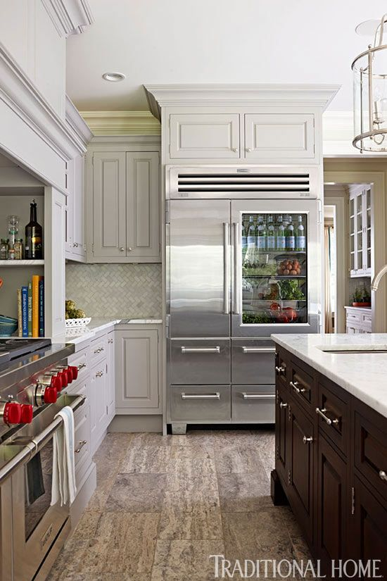 A cool glass-front Sub-Zero refrigerator offers quick views of what's on hand. - Photo: Steven Randazzo / Design: Mel Elion