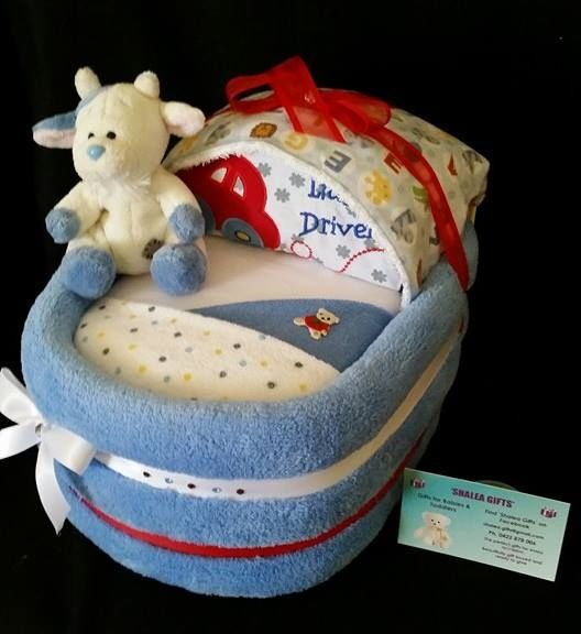 SMALL BASSINETBaby Gift Shalea Gifts Design   Contains - 30 Infant Nappies, 1 Baby Singlet, 1 Baby Winter/Summer Onsie, 2 x Baby Bibs, 1 Baby Wrap, 1 Over the Shoulder Burp Cloth, 1 Baby Wash Cloth, 1 BNF Plush Toy -  Decorated Embellished, Finished with Cellophane & Ribbon