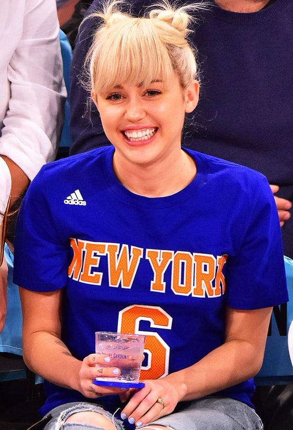 CWEB.com - Celebrity Miley Cyrus Wears Engagement Ring at Knicks Game With Mom and Sister. Check Out That Big Rock!