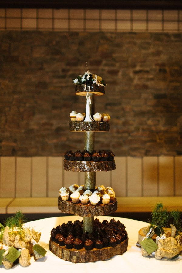"""Homemade log cake stand with fisherman groom """"catching"""" his bride"""