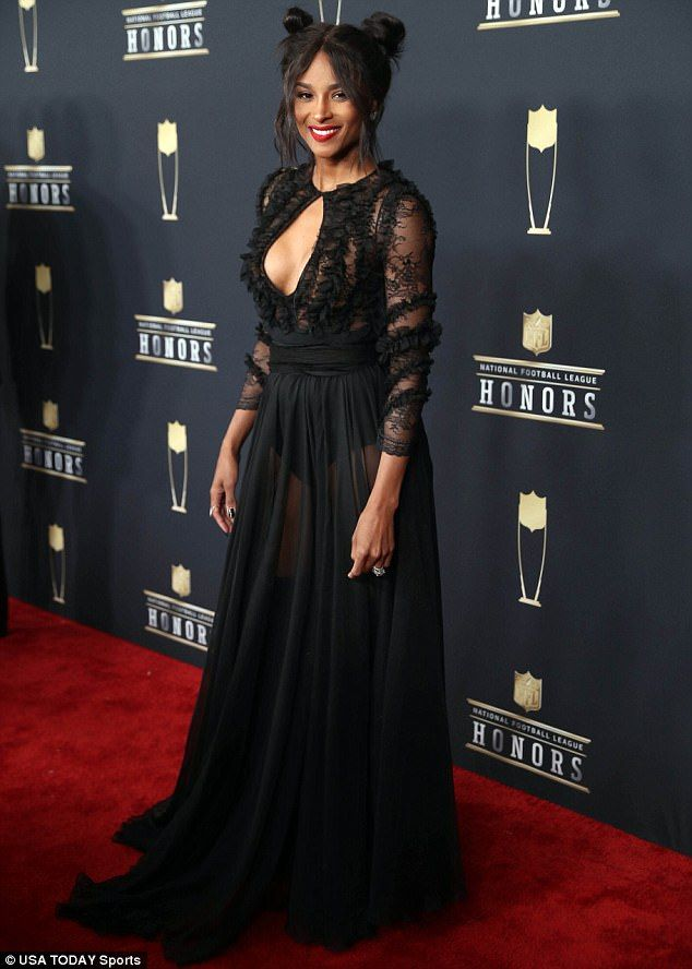 The 7th Annual NFL Honors Awards - Ciara, 32, simply smoldered in the longsleeved, floor-length gown which offered up an eyeful of cleavage with a keyhole bust. She is married to Russell Wilson, who is the quarterback for the Seattle Seahawks, was at her side.