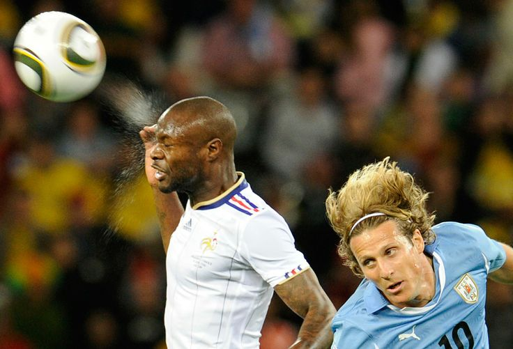 Diego Forlan tries to head the ball with France's William Gallas during their Group A first round World Cup match on June 11, 2010 at Green Point stadium in Cape Town. (STEPHANE DE SAKUTIN/AFP/Getty Images)