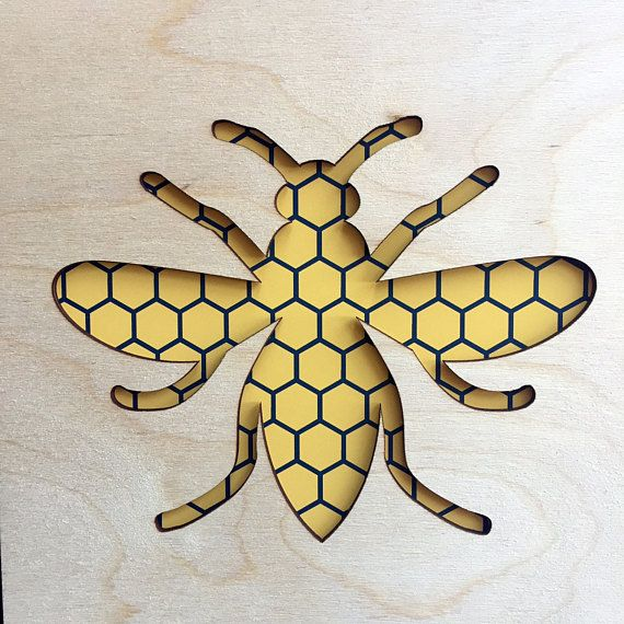 This striking Honeycomb Bee lasercut wall art is a must have for lovers of modern Manchester, and its rich industrial history. The worker bee was adopted as a motif for Manchester during the Industrial Revolution  This contemporary wall art, combines a lasercut plywood bee cut out, with a modern honeycomb inspired art print behind and measures 23cm x 23cm  Please note, this lasercut product is NOT framed.  The photograph shows an Ikea Ribba Frame, available in black or white so you can…