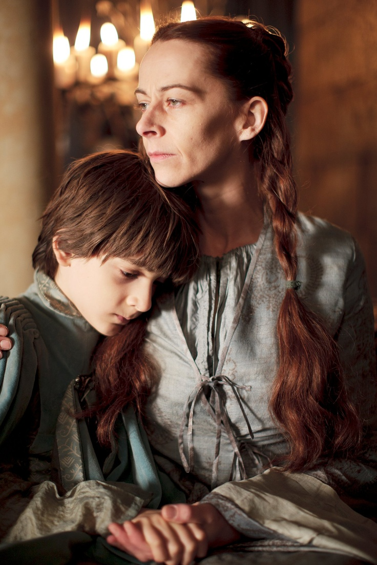 Kate Dickie as Lysa Tully Arryn and Lino Facioli as Robin Arryn in Game of Thrones