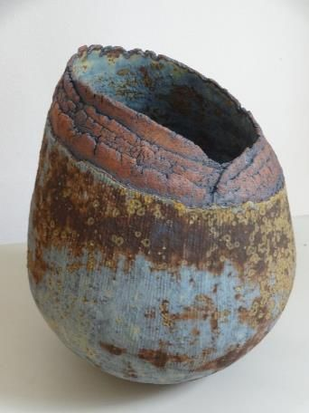 Jasmina Ajzenkol = All pieces are hand built using stoneware body.  I like contrast between rough and smooth, glazed and textured clay surfaces.  I combine the contrasting techniques of layering, distressing the surface of pots by scratching and carving into clay, and burnishing to create a three-dimensional texture using a series of different levels and depths encouraging the eye to move in, rather than bounce away.  These are enhanced by the subsequent use of oxides and glazes.
