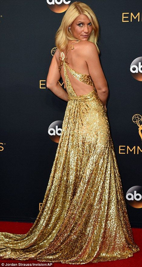 Golden girl: Claire Danes, who was once again nominated for Homeland, showed off her flawless red carpet style in gold