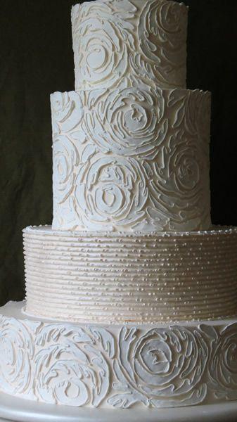 Beautiful wedding cake, all done in Italian buttercream. I love this! Impressionistic yet patterned. Cake by Jim Smeal, South Carolina.