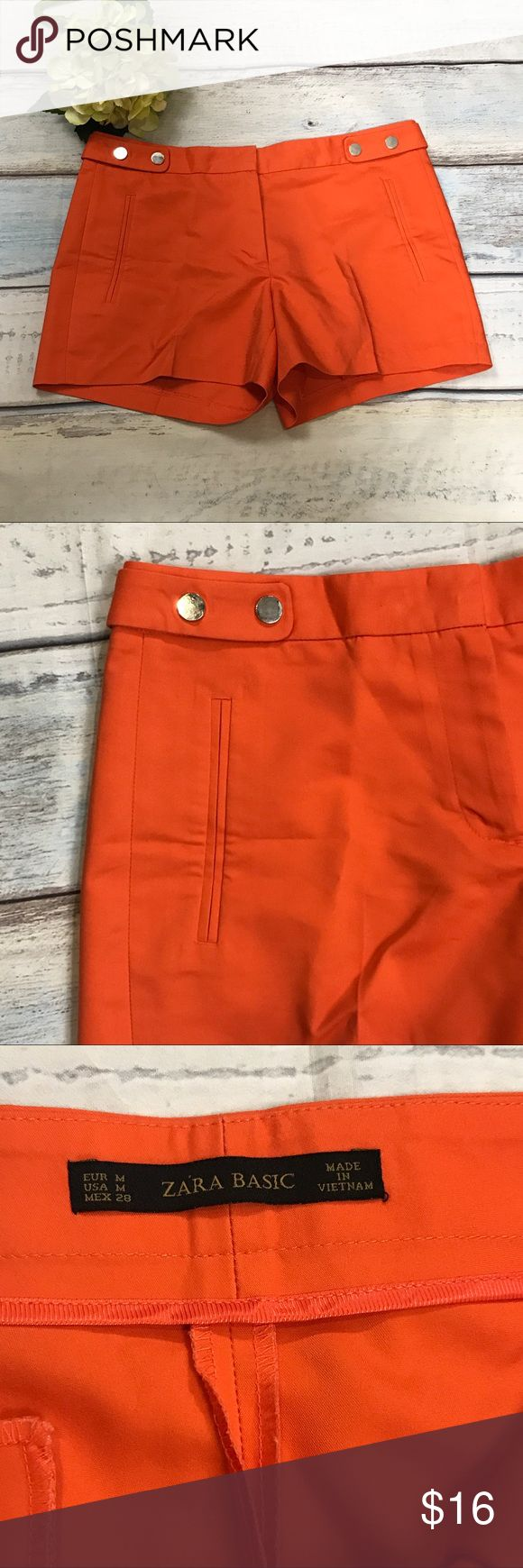 Zara Basic Sz M Orange Double Cloth shorts Zara Basic Womens Sz M Orange Double Cloth shorts Press Studs at Waist Mid Cargo  If there is one season you can go crazy with vibrant colors, it's summer. These vivid orange shorts are so much more fun than a regular khaki pair.  Features: - 2 front slant pockets - double cloth - pressed studs at waist - zip front with hook eye and button closure - 1 faux rear pocket - flat front - slight stretch  Condition: tags have been removed  Approximate…
