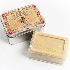 Savon LeBlanc Honey Soap in Honey Bee Tin  LeBlanc's range of soaps are made by craftsmen in the south of France and contains 100% vegetable oil. Soap is enriched with shea butter which imparts softness to the skin. Their soaps are made in Saint-Remy-de-Provence, while their delicate floral fragrances come from Grasse, France's famous capital of perfume.