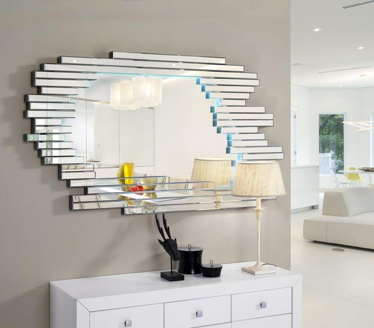 espejo piastrella ovalado con luzespejo ovalado con marco formado por tiras de espejo biseladas iluminado