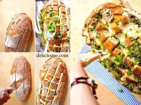 Ingrediente: 100 g brânză sau caşcaval, 100 g mozzarella, 2 legături de usturoi verde, 1 pâine mare (de 400 g), 100 g unt, 2 linguri de seminţe de susan (opţional), un praf de piper, 1 legatură de pătrunjel. Moddepreparare: Se crestează pâinea pe lungime şi pe lăţime, fara a se taia de tot partea de jos. Se taie usturoiul şi se amestecă împreună cu untul topit şi seminţele de susan. Se pune in tava o folie de aluminiu şi se aseaza pâinea. In spatiile create se introduce untul si usturoiul…
