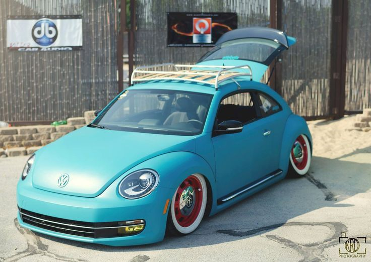 Old School New Beetle Wrapped In Teal Wooden Roof Rack