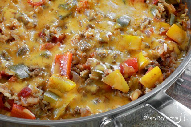This lazy stuffed peppers recipe is a one-pot wonder for dinner! 2 Tbsp olive oil 1 lb extra-lean ground beef 1 medium yellow onion, finely diced 3 bell peppers, seeded and diced large 2 cloves garlic, minced 14.5 oz can petite diced tomatoes, with juices 14.5 oz can chicken or beef broth 8 oz can tomato sauce 2 tsp beef or chicken bouillon 2 tsp Worcestershire sauce 1 tsp Italian seasoning or oregano 1 cup white long grain rice, uncooked 1½ cups shredded cheddar cheese
