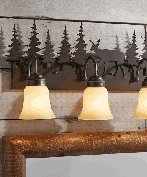 Rustic Vanity Light Fixtures Rustic Vanity Light Fixtures: Add grace and warmth to your room with the Canyon 3 Light Vanity. This lodge vanity light is made from metal and features deer and pine tree silhouettes. Finished in burnished bronze with amber flake glass shades and uses three 100-watt max bulbs. UL listed for damp locations.