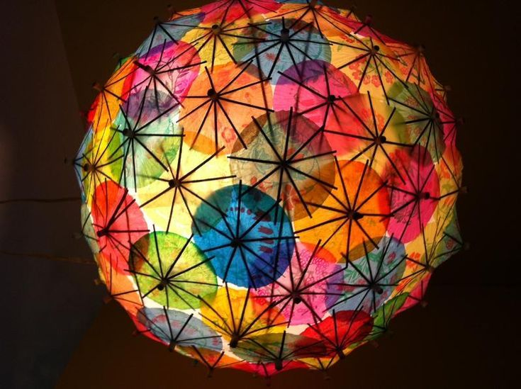 how fun is this!  paper lantern decorated with paper drink umbrellas.  For that special summer patio party