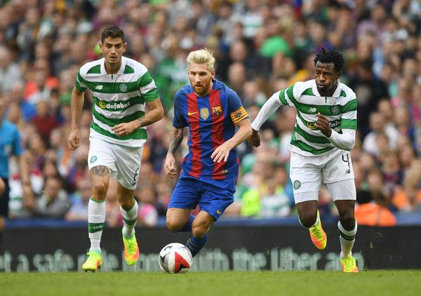Lionel Messi (C) of Barcelona and Nir Bitton (L) and Efe Ambrose (R) of Celtic during the International Champions Cup series match between…