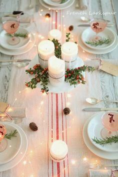 French-style Christmas table, with fairy lights & candles on cake stand. Love this French country Christmas style! So chic and fresh.