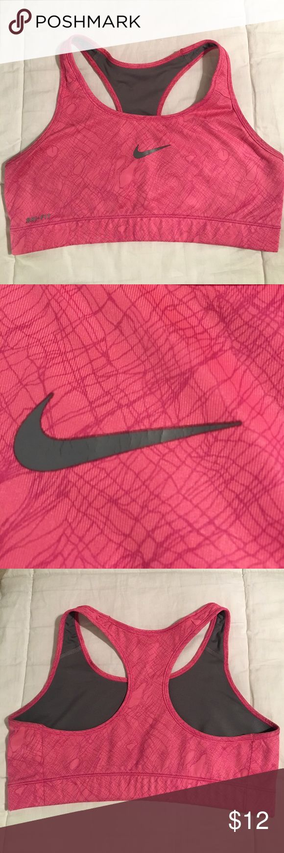 Nike hot pink and gray sports bra Cute hot pink and light gray pattern sports bra. Great condition. No rips or stains. Medium to high impact support Nike Intimates & Sleepwear Bras