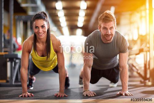 """Laden Sie das lizenzfreie Foto """"Couple doing exercise for arms"""" von luckybusiness zum günstigen Preis auf Fotolia.com herunter. Stöbern Sie in unserer Bilddatenbank und finden Sie schnell das perfekte Stockfoto für Ihr Marketing-Projekt!"""