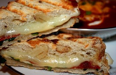 Pepperoni Pizza Grilled Cheese - Layers of mozzarella and provolone cheese, pepperoni, and a bit of marinara sauce and fresh basil are tucked into an artisan bread and grilled. Serve with a commercial or homemade tomato soup.
