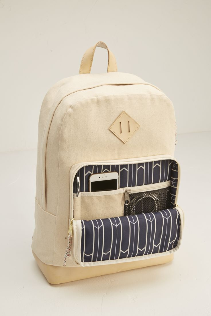#JanSport Axiom natural canvas #backpack from the new #WaywardCollection. Legendary JanSport durability meets jetsetter style. The new Wayward Collection is created from 100% cotton canvas with premium leather trim and thoughtful details. Features a suede leather bottom and faded navy wayward arrows print on canvas.