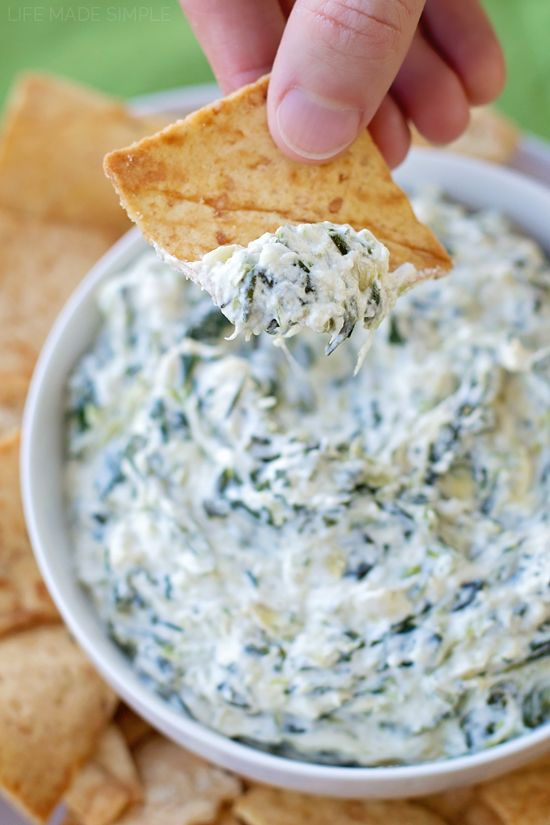 You'd never be able to guess that this 15 minute skinny spinach artichoke dip is actually just that- skinny! It's totally lightened up but has just as much flavor!