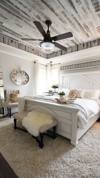 Modern French Country style bedroom with rustic barnwood ceiling