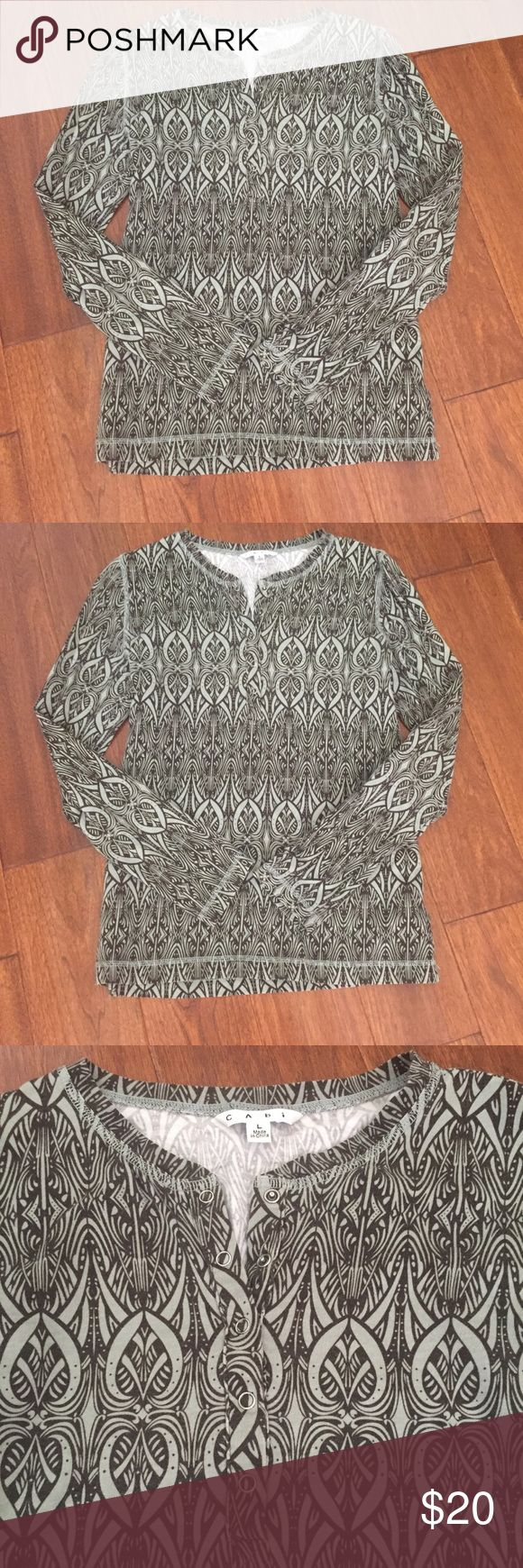 Cabi Henley Long sleeve top has five snaps in center front to adjust to your liking. Comfort fit. 95% cotton, 5% spandex. Color is soft brown and aqua Tops