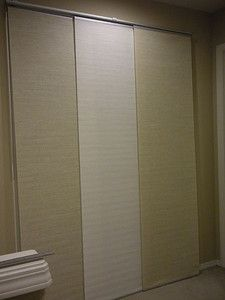 Ikea panel curtains on furnace & H2O heater closet (in place of the ugly poor fitting bi-fold doors)