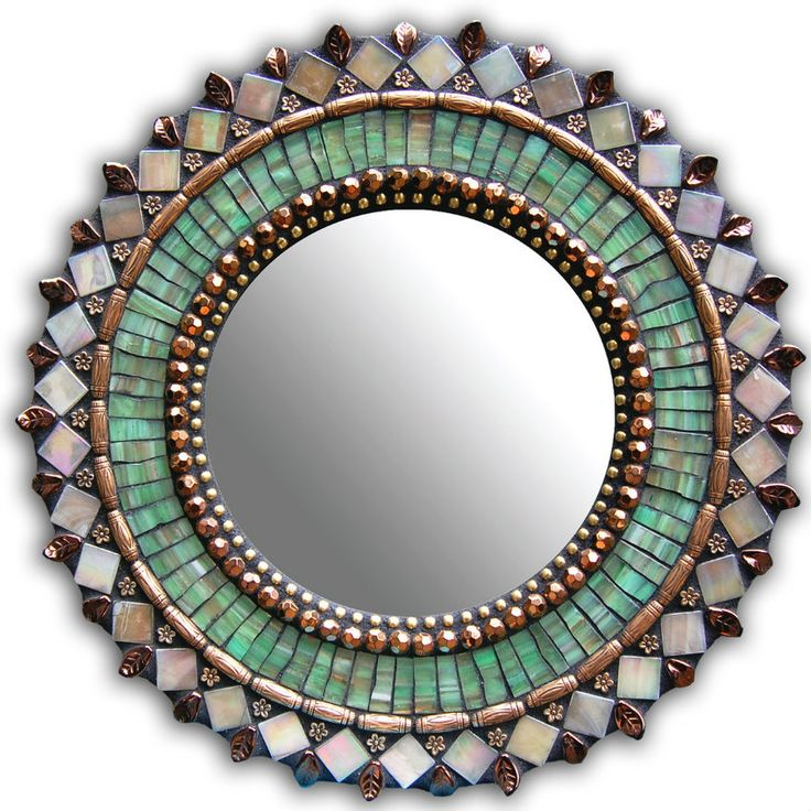 Developed by Angie Heinrich, this entitled 13in Round Mosaic Mirror is inspired by Greek and Moroccan art and architecture.