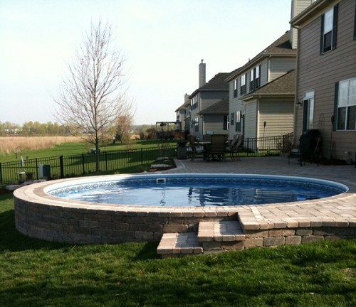 Semi Inground Pool Ideas semi inground pools are becoming very popular many people might have a high water table rock a hillside or any number of uncontrollable factors which Semi Inground Radiant Metric Round Pool With Pavers