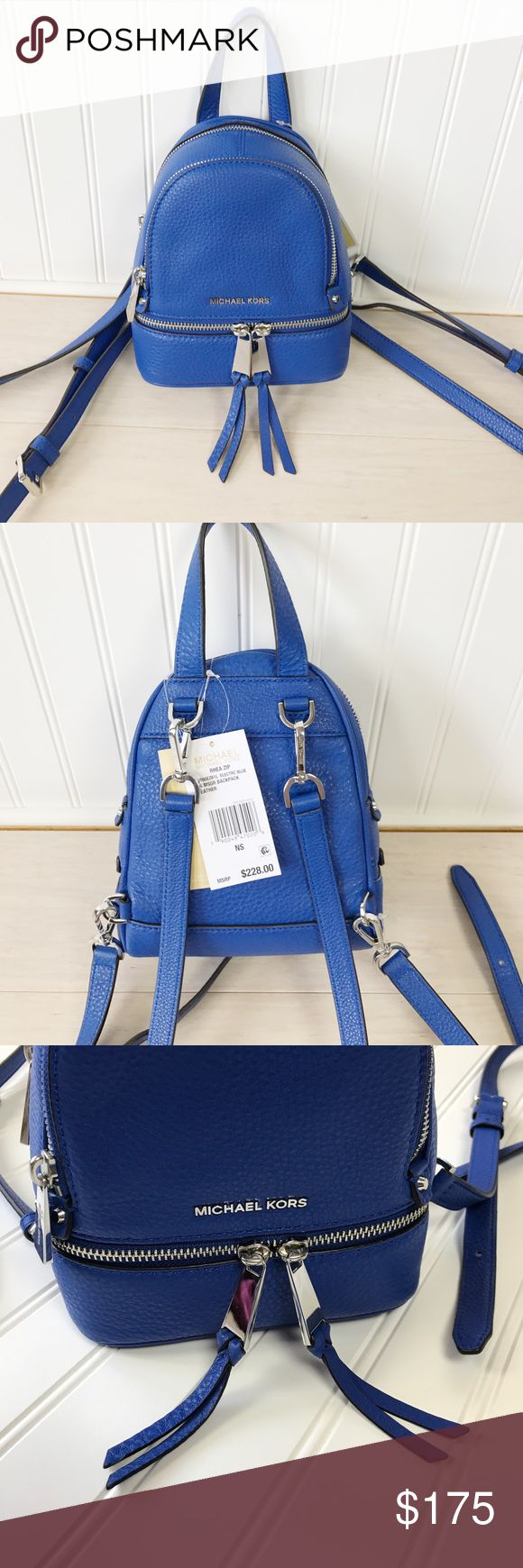"""Michael Kors xs messenger backpack! Beautiful, NWT, extra small Michael Kors Rhea Zip Electric Blue leather convertible messenger/ backpack. By moving the straps, it changes from a backpack to a crossbody style. Features: *Electric Blue leather *7"""" lon"""