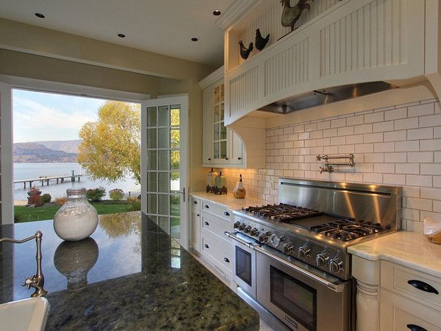 Dreamy kitchen with spectacular views. Lake House  Kelowna, British Columbia, Canada  via Jane Hoffman  homebunch.com