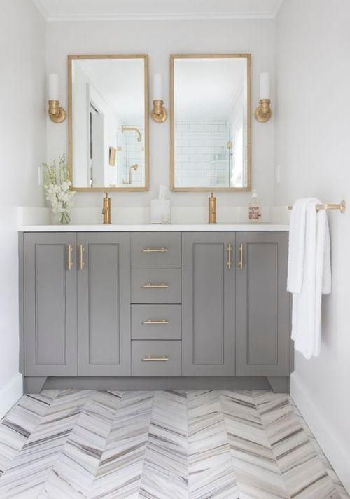 I like the gold hardware on the light gray cabinets, and the interest the floor offers