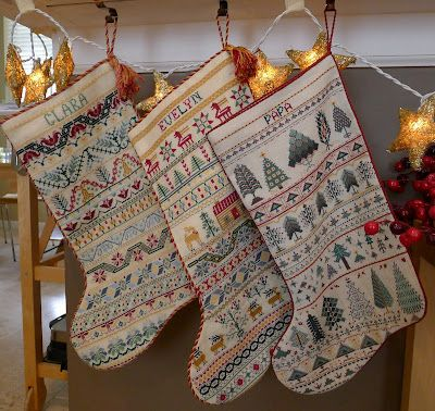 Cross stitch Christmas Stockings I love making these for my kids. Only not this pattern.
