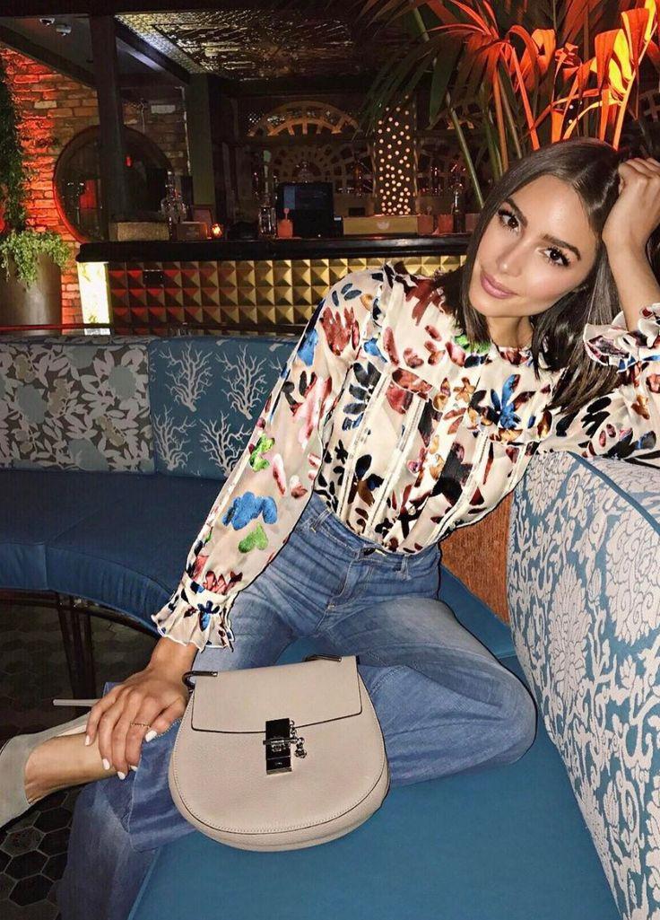 Who made Olivia Culpo's floral top, tan handbag, and beige pumps?